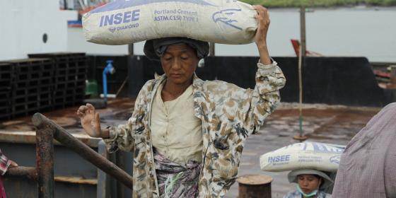 An elderly woman carrying pack on her head in Kyauk Phyu where Special Economic Zone will take place. Photo by: Soe Win Nyein/ Oxfam